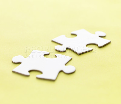 Buy stock photo Two jigsaw puzzle pieces on a yellow background