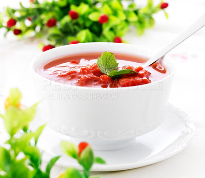 Buy stock photo Hot fresh tomato soup in a bowl on dining table