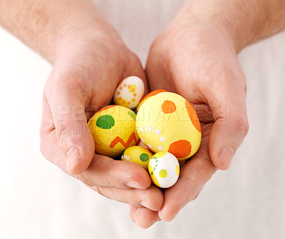 Buy stock photo Closeup of human hand showing handmade colorful easter eggs