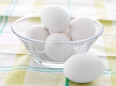 Buy stock photo Closeup of white eggs in a glass bowl on a tablecloth