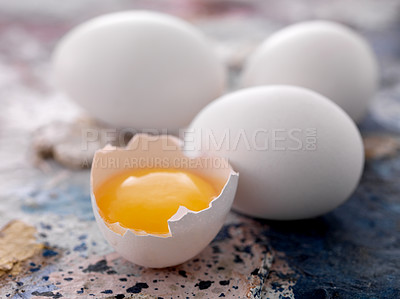 Buy stock photo Half broken egg with whole raw eggs on dirty floor