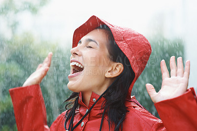 Buy stock photo Pretty woman playing in the rain