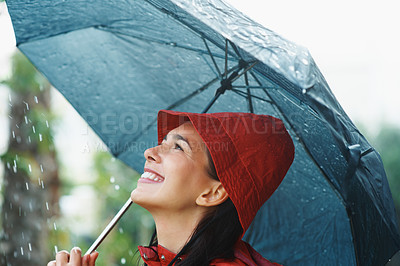 Buy stock photo Woman wearing raincoat and holding umbrella