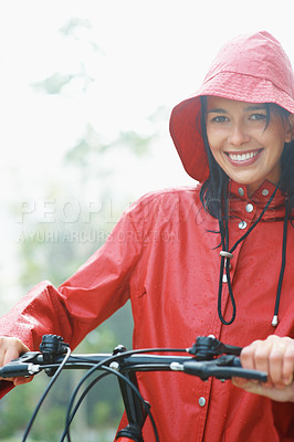 Buy stock photo Woman in raincoat and hat, going for bike ride