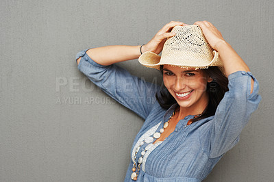 Buy stock photo Pretty woman smiling while holding cowboy hat to head