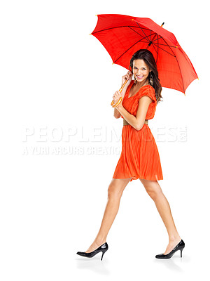 Buy stock photo Portrait of happy young female with a red umbrella walking on white background