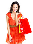 Happy young female holding shopping bags against white