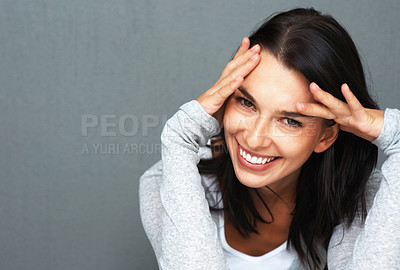 Buy stock photo Pretty woman holding her head and smiling