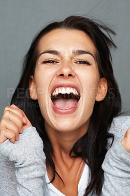 Buy stock photo View of young woman expressing frustration