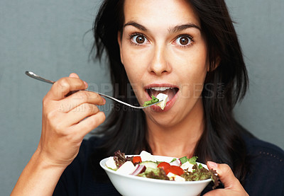 Buy stock photo Pretty woman eating bowl of salad