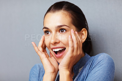 Buy stock photo Closeup of smiling woman looking surprised on grey background