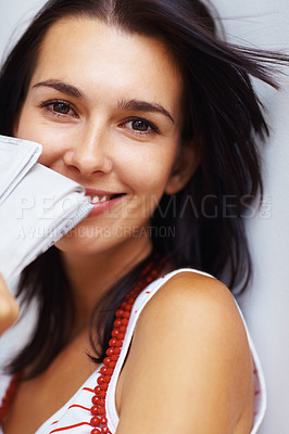 Buy stock photo Portrait of happy beautiful woman holding newspaper