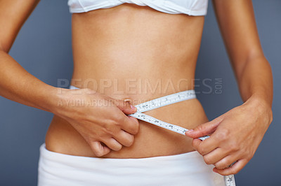 Buy stock photo Cropped image of woman measuring her perfect waist