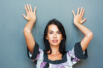 Buy stock photo Portrait of pretty young woman leaning against wall
