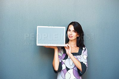 Buy stock photo Portrait of pretty young woman standing and holding laptop