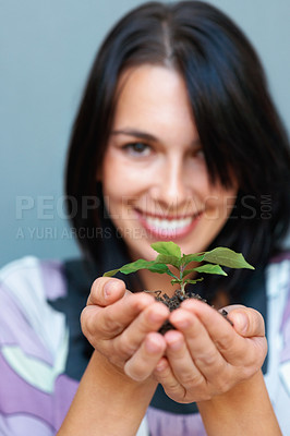 Buy stock photo Portrait of smiling woman holding plant in her hand