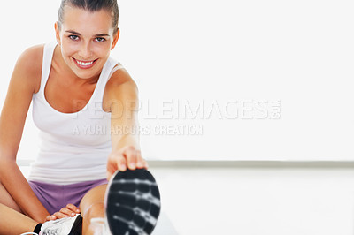 Buy stock photo Portrait of smiling young woman stretches her leg - copyspace