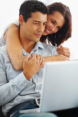Buy stock photo Portrait of romantic young couple using laptop on white background