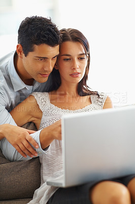 Buy stock photo Young man and woman working on laptop at home