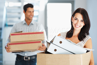 Buy stock photo Man and woman smiling as they are carrying boxes of files in an office - copyspace