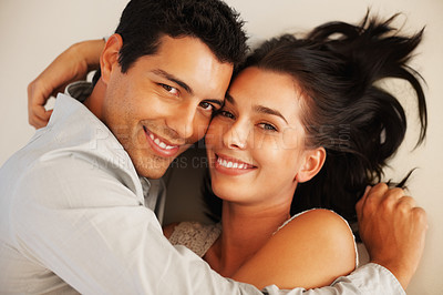 Buy stock photo Closeup of cute young couple smiling while lying on floor