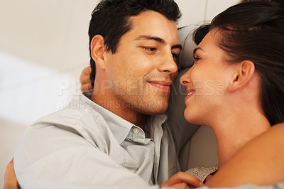Buy stock photo Closeup of young couple lying on floor and looking at each other