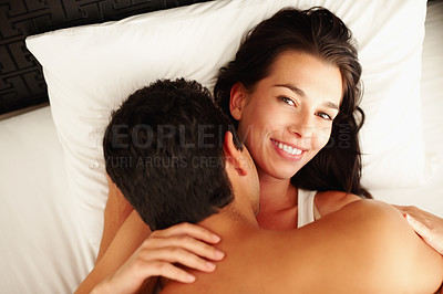 Buy stock photo Portrait of young couple romancing in bed