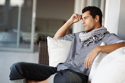 Buy stock photo Portrait of stylish young man relaxing on couch and looking away