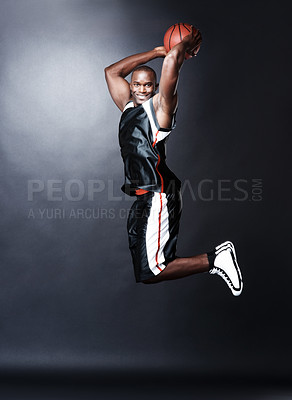 Buy stock photo Sporty handsome African American man jumping in the air reaching for the basket - Basketball game