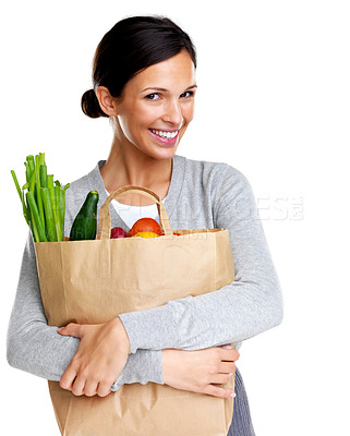Buy stock photo Portrait of an attractive young woman holding a grocery bag in hand and smiling on white background