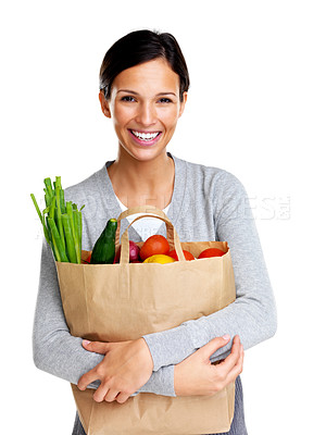 Buy stock photo Portrait of a pretty young woman holding a grocery bag and smiling against white background