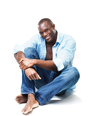 Buy stock photo Portrait of a young attractive african american casual man sitting relax on floor over white background