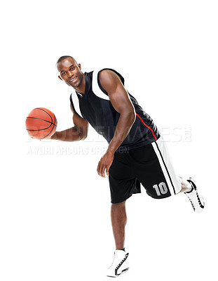Buy stock photo Portrait of a professional young basket player in action  against white background