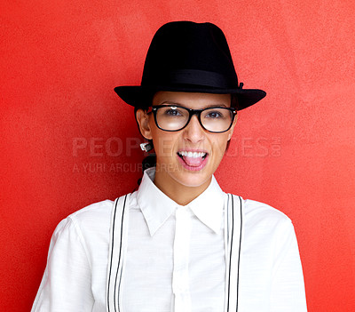 Buy stock photo Portrait of a naughty young female making funny face against red background