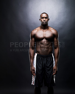 Buy stock photo Portrait of a muscular young guy standing against dark background - Copyspace