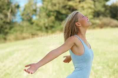 Buy stock photo Side view of woman with arms outstretched at the park