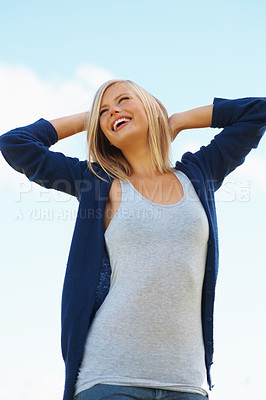 Buy stock photo Happy pretty woman looking up at the sky on sunny day
