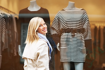 Buy stock photo Shopaholic woman in front of clothing store