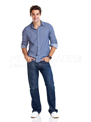 Buy stock photo Full length portrait of a stylish young man standing with hands in pockets over white background