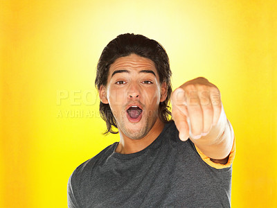 Buy stock photo Attractive man pointing at you with surprised look