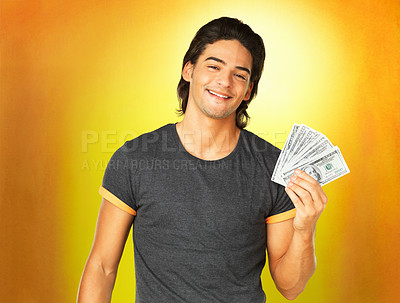 Buy stock photo Handsome standing against yellow background while holding money
