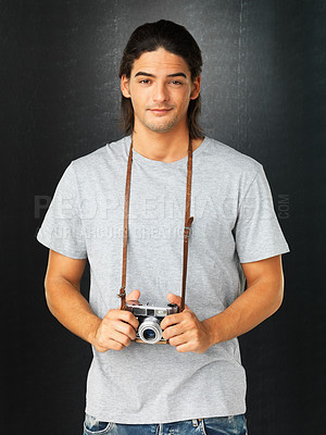 Buy stock photo Young handsome man holding his vintage camera and smiling