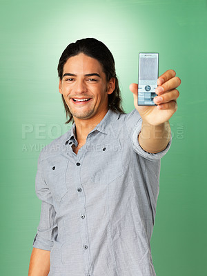 Buy stock photo Smiling man showing photograph he just took with phone