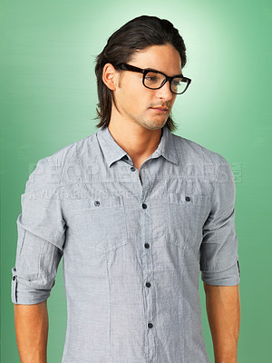 Buy stock photo View of handsome man wearing glasses and looking into distance