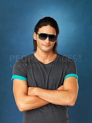 Buy stock photo View of handsome man with arms folded and wearing sunglasses
