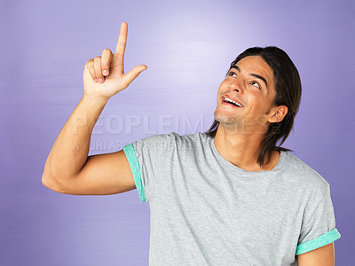 Buy stock photo Excited man points up
