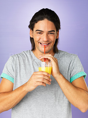 Buy stock photo Handsome man sipping juice through straw