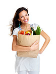 An attractive young woman holding vegetable bag