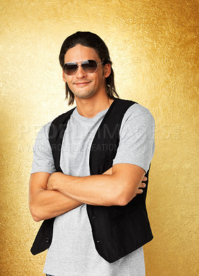 Buy stock photo Attractive man with arms folded while wearing vest and sunglasses