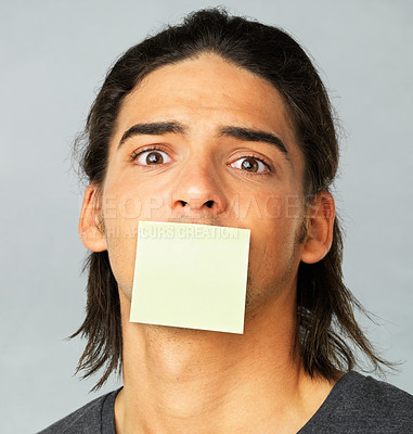 Buy stock photo Closeup of young man with adhesive note over his mouth